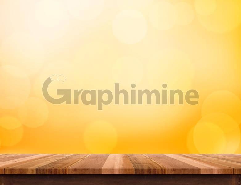 تصویر استوک پس زمینه بوکه میز چوبی